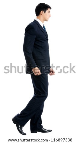 Full body portrait of walking young business man, isolated over white background
