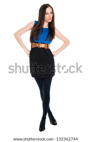 Full body portrait of young attractive brunette with hands on her hips, isolated on white background - stock photo