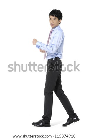 Full body Portrait of young business man walking - stock photo