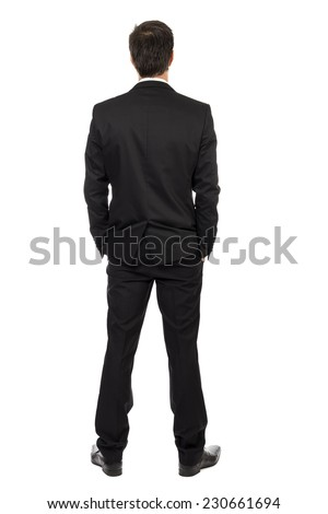 Full body portrait of young businessman, back view, with hands in pocket isolated over white background  - stock photo