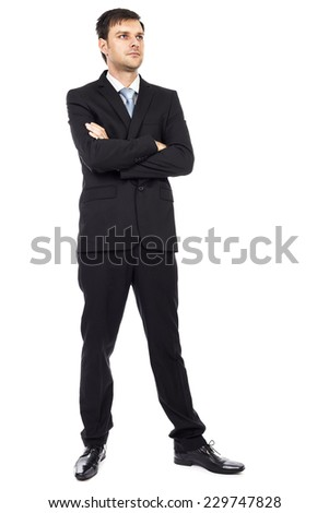 Full body portrait of  young businessman with arms folded isolated over white background - stock photo
