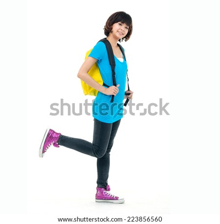 Full body Pretty female student carrying notebook - stock photo