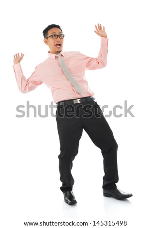 Full body shocked young Asian businessman open arms body bend backwards, isolated on white background - stock photo