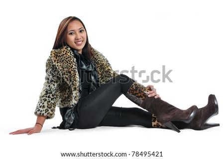 Full body shot of a beautiful, cheerful and smiling young lady in fashion isolated on white background.