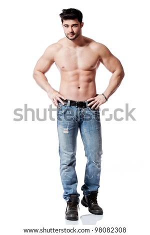 full body shot of a handsome young man, wearing blue jeans - stock photo