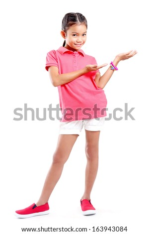 Full body shot of a young girl introducing something. - stock photo