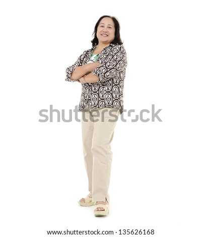 full body shot of cheerful Asian senior woman, - stock photo