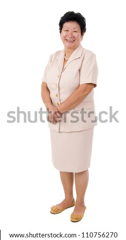 full body shot of cheerful Asian senior woman, isolated on white - stock photo