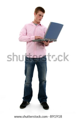 Full body shot of cute freckled male teen with laptop. - stock photo