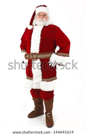 Full Body Shot of Santa Claus with his hands on his hips isolated on white background - stock photo
