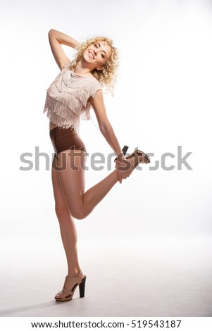 full-body shot. White background. isolated. girl posing. curly hair, blonde,