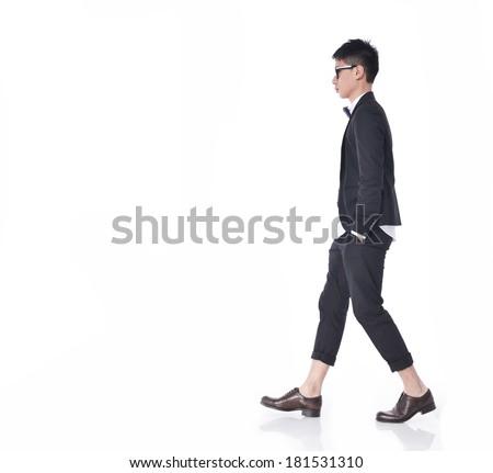 Full body side view of a fashion man walking forward  - stock photo
