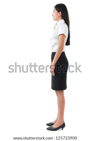 Full body side view of beautiful Asian young woman standing on white background - stock photo