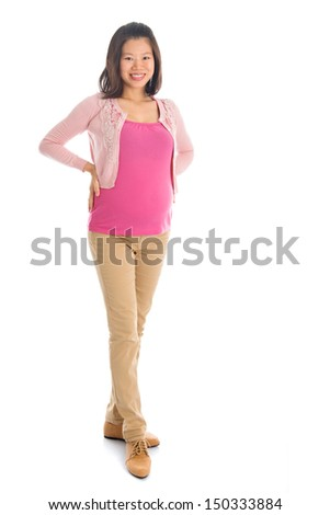 Full body six months pregnant Asian woman standing isolated on white background. - stock photo