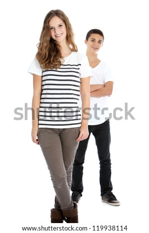 Full body studio portrait of two smiling young trendy teenagers in smart casual clothes with the girl in the foreground and boy behind isolated on white - stock photo