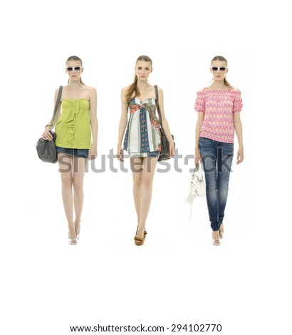 Full body three young girl in jeans and with bag posing on white background