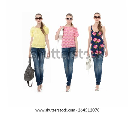 fUll body three young girl in jeans with sunglasses and bag walking in studio