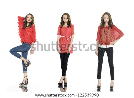 Full body three young woman in red clothes posing in studio - stock photo