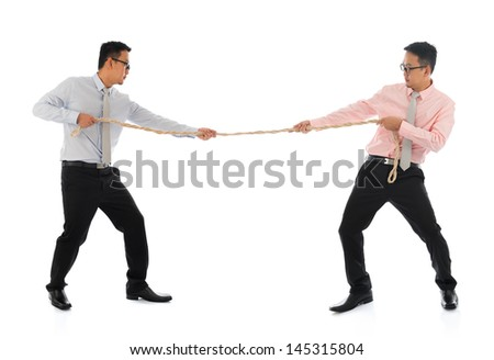 Full body two Asian businessmen pulling a rope, isolated on white background. Asian male model. - stock photo