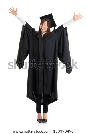 Full body university student. Excited Asian female in graduation gown hands raised open arms jumping isolated on white background. - stock photo