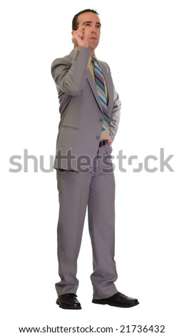Full body view of a young businessman throwing a dart, isolated against a white background