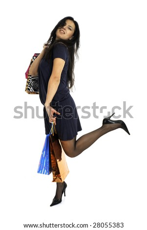 Full body view of young attractive woman in elegant wear, going shopping with lots of colorful shopping bags. Isolated on white background.