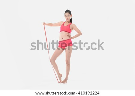 Full body woman with perfect shapes and measure posing - stock photo