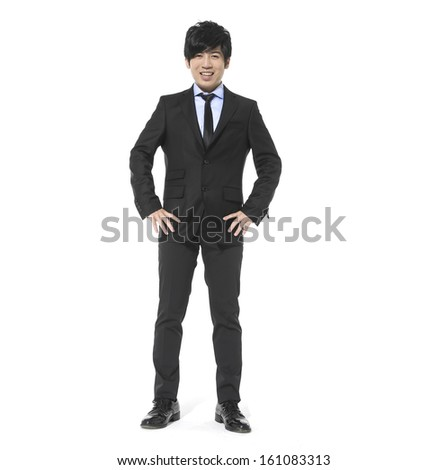 Full body young attractive and confident businessman with his hands in pockets,