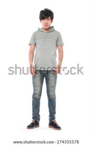 Full body young attractive and confident man with his hands in pockets,  - stock photo