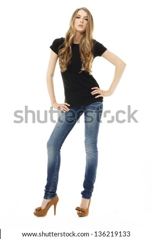 Full body young blonde woman in blue jeans posing on white background
