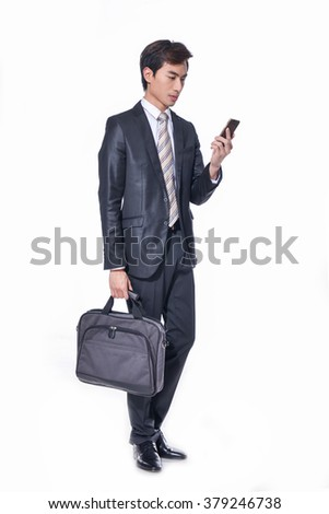 Full body young business man carrying a suitcase on white background - stock photo