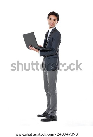 Full body young business man holding a laptop bag on white background - stock photo