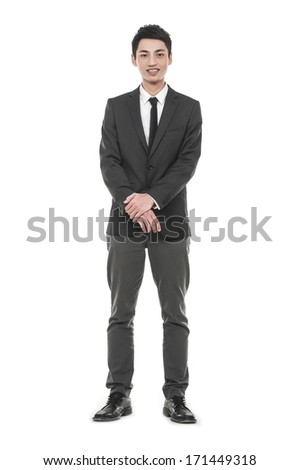 Full body young business man portrait isolated on light background - stock photo