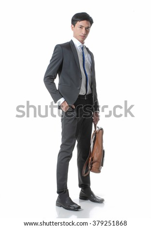 Full body young business man portrait with bag in studio - stock photo