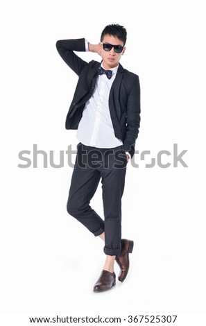Full body young businessman in sunglasses standing