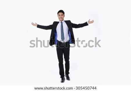 Full body young businessman lifting arms in excitement - stock photo