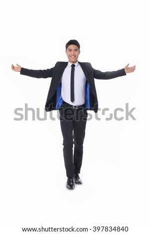 Full body young businessman lifting arms in excitement