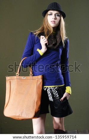 full body young fashion model in hat with bag posing o - stock photo