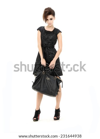 Full body Young fashion woman in black dress. Isolated  - stock photo