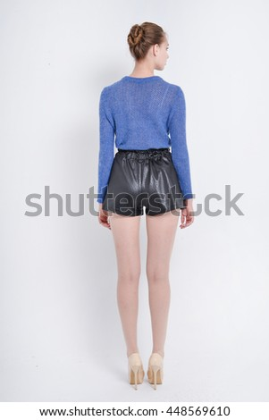 Full body young girl back posing shot in studio   - stock photo