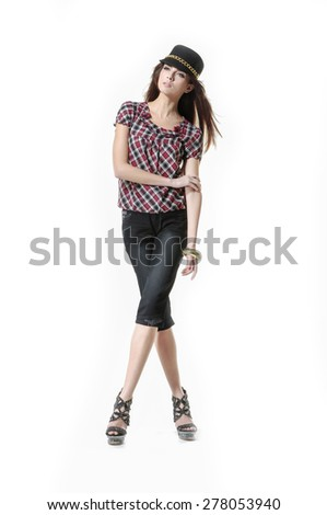 Full body young girl in hat posing on white background - stock photo