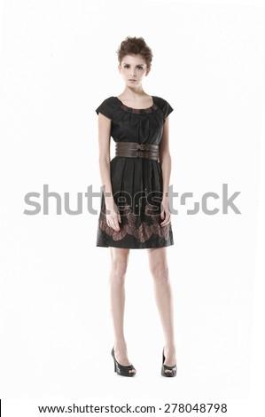 Full body young girl wearing black dress posing - stock photo