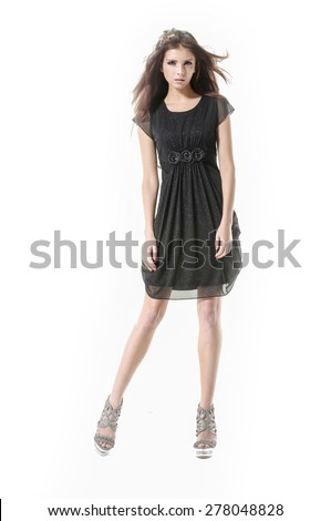 Full body young girl wearing black dress posing - stock photo