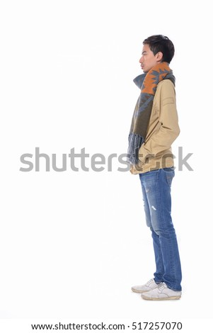 Full body young handsome man fashion in scarf ,jeans portrait-side view