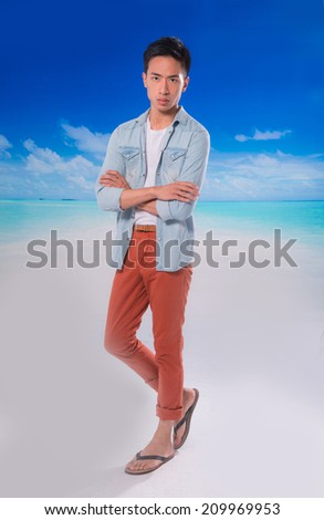 Full body Young handsome man relaxing at the beach