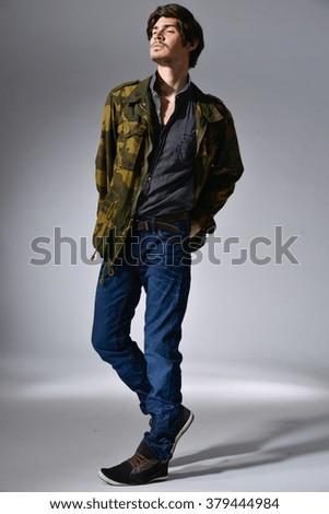 Full body Young mal model in jeans posing in the studio - stock photo
