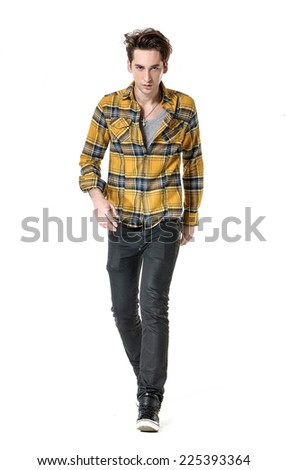 Full body young Man in Casual Clothes walking in studio