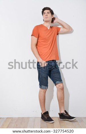 Full body young Man in Casual Clothes walking wooden background - stock photo
