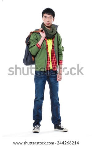 Full body Young man in jeans standing with bag on white background - stock photo