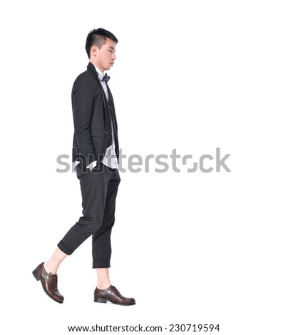 Full body young man in sunglasses walking - stock photo